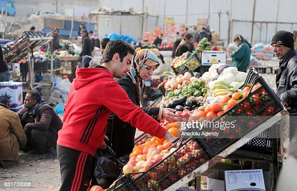Internally relocated Iraqi people are seen at an outdoor market in Gokcheli district which is under the control of Iraqi Army forces in eastern Mosul...