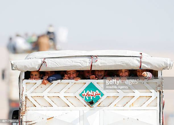 Internally relocated people fleeing from the villages and neighborhoods from eastern Mosul arrive at the check point at the Bartella front in...