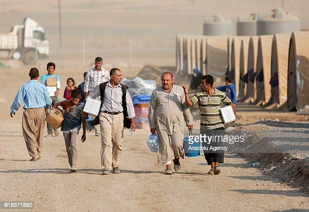 Internally relocated people fleeing from the villages of Mosul due to Daesh arrive at Hazir camp in Nineveh Iraq on October 26 2016