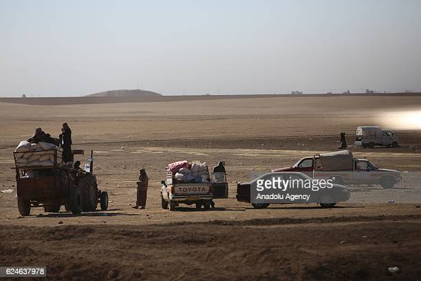 Internally relocated people, who fled their homes due to the clashes, wait to be placed to refugee camps, at Omerkapci village of Bashiqa town in...