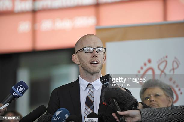 International AIDS Society executive director Owen Ryan of Switzerland addresses the media with news on fallen delegates travelling to the AIDS...