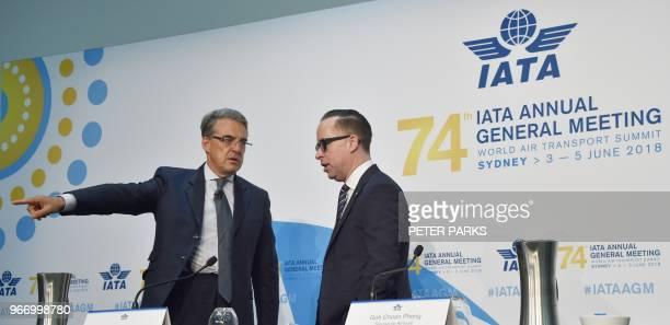 International Air Transport Association chief executive Alexandre de Juniac speaks with Qantas chief executive Alan Joyce before a press conference...