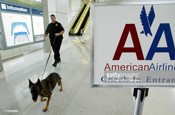 DFW International Airport Police Sgt Jon Taylor and his K9 partner Kira search for liquid explosives at DFW's international terminal Terminal D after...