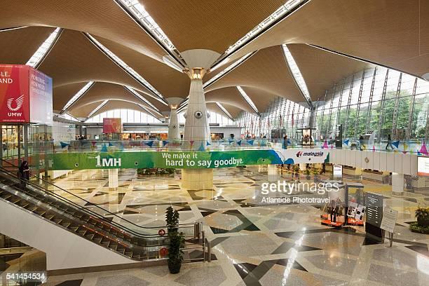 kl international airport, the interior - kuala lumpur international airport stock photos and pictures