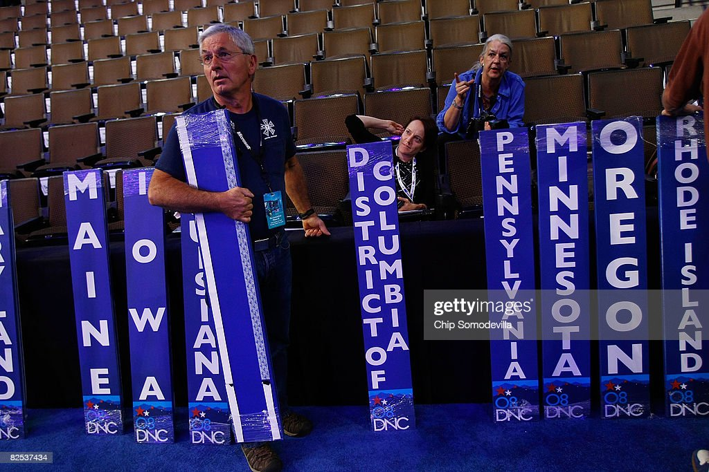 International Alliance of Theatrical Stage Employees Union Local 7 Mike Weymore moves various State signs with larger type into position at the Pepsi Center August 24, 2008 in Denver, Colorado. The DNC begins August 25 where U.S. Sen. Barack Obama (D-IL) will be officially nominated as the Democratic nominee for U.S. president.