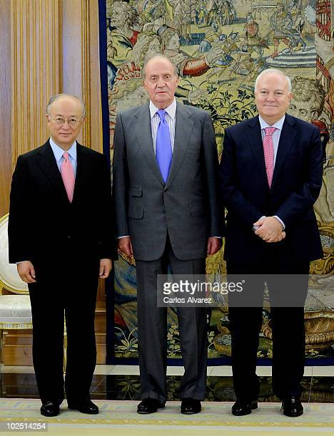 International Atomic Energy Agency Director Yukiya Amano, King Juan Carlos of Spain and Spanish Foreign Minister Miguel Angel Moratinos pose for a...