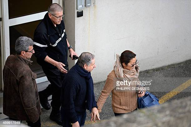 International Automobile Federation President Jean Todt and his wife Michelle Yeoh leave the Grenoble University Hospital Centre after they visited...
