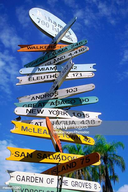 international bazaar signpost in freeport, grand bahamas - freeport bahamas stock photos and pictures