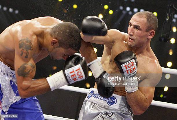 """International Boxing Federation middleweight world champion German'y """"King"""" Arthur Abraham challenges Britain's Wayne Elcock during their fight 08..."""