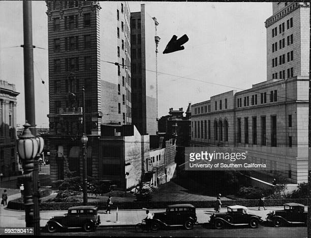 International Building, shown by arrow, which obscures view of Temple Street entrance to City Hall, It is proposed to move it across Main Street, Los...
