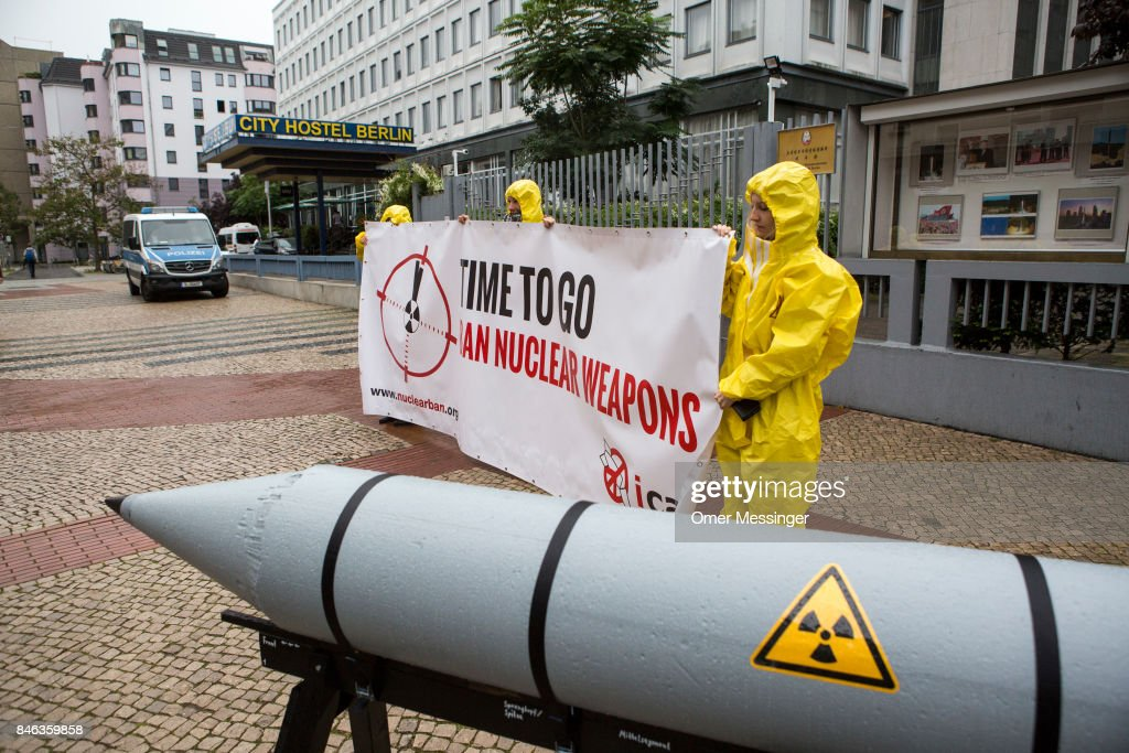 International campaign to abolish Nuclear Weapons (ICAN) activists wearing yellow hazard suits are seen next to a Styrofoam effigy of a nuclear bomb after protesting in front of the North Korean Embassy on September 13, 2017 in Berlin, Germany. The protests, which were organized by anti-nuclear and pro-peace group ICAN, took place at both the North Korean and US embassies.