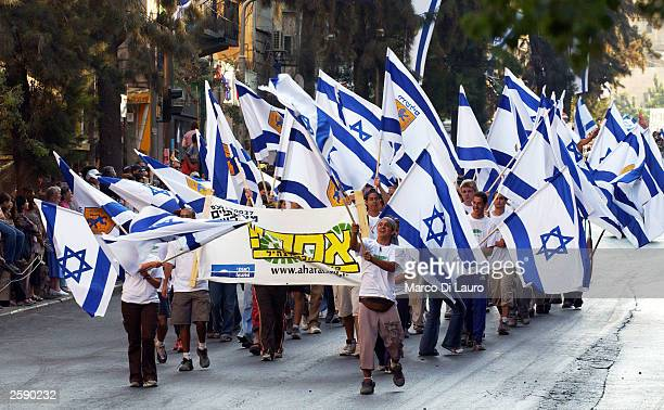International Christian Embassy pilgrims march during the celebration of the Jewish holiday of Sukkot October 14, 2003 in Jerusalem, Israel. Over...