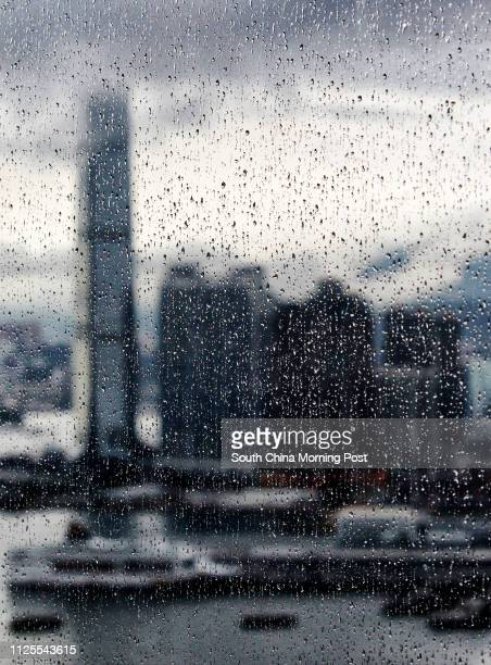 International Commerce Centre is seen behind the rain drops on the window 11JUN13 [BACKPAGE ON 16 JUN 2013]