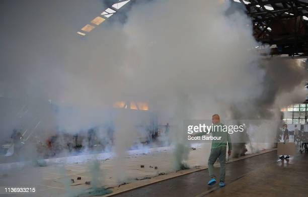 International contemporary artist Cai GuoQiang looks on after creating a new work from fire and gunpowder at Seaworks on March 20 2019 in Melbourne...