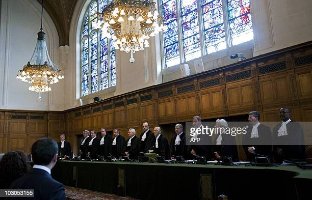 International Court of Justice's members stand prior to the trial of the declaration of independence of Kosovo, on July 22, 2010 in the Peace Palace...