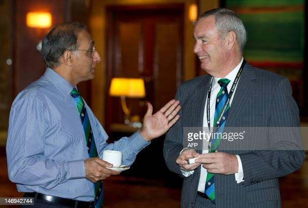 International Cricket Council Chief Executive Haroon Lorgat shares a light moment with VicePresident Alan Isaac during the International Cricket...