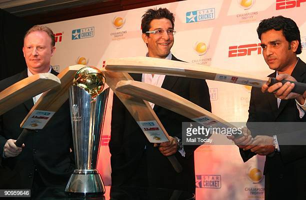 International Cricket Council General Manager Commercial Campbell Jamieson cricketers Sanjay Manjrekar and Wasim Akram pose with a replica of The ICC...