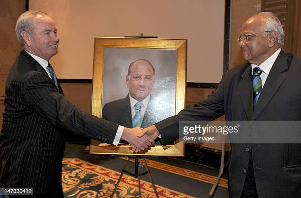 International Cricket Council President Sharad Pawar shakes greets the new ICC President Alan Isaac during the ICC Annual Conference held at the...
