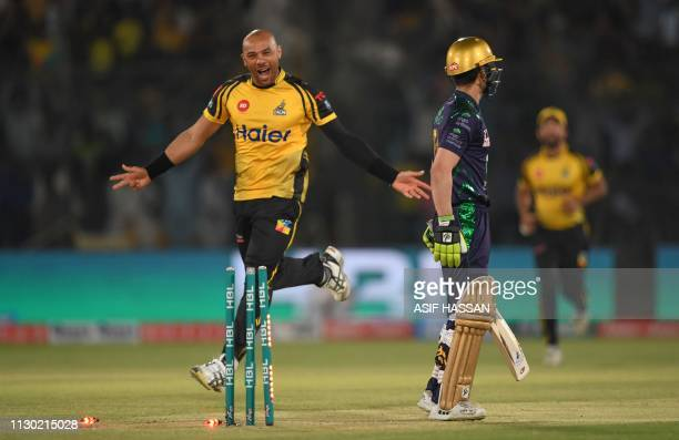 International cricketer Tymal Mills of Peshawar Zalmi celebrates after taking the wicket of Ahmed Shahzad of Pakistan Quetta Gladiators during the...