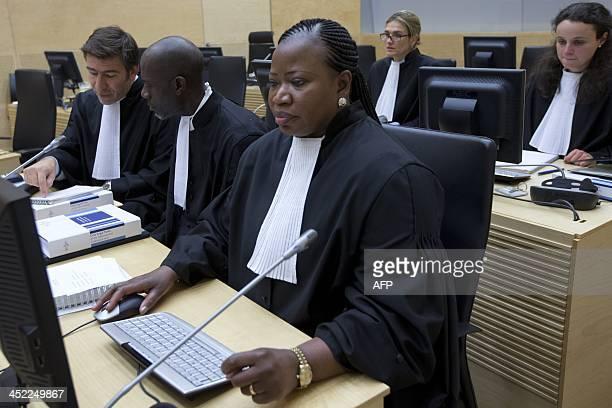 International Criminal Court Chief Prosecutor Fatou Bensouda sits next to ICC Senior Appeals Counsel Fabricio Guariglia and ICC counsel Kweku...