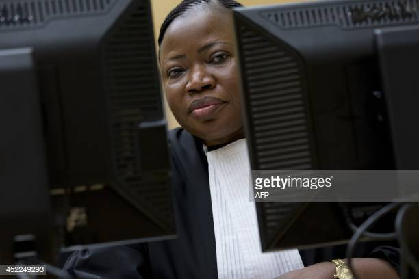International Criminal Court Chief Prosecutor Fatou Bensouda waits on November 27 2013 for the start of the trial of Congolese Vice President...