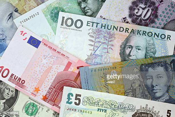 international currencies : euro, pound, dollar, kroner banknotes topview - kroon hoofddeksel stockfoto's en -beelden