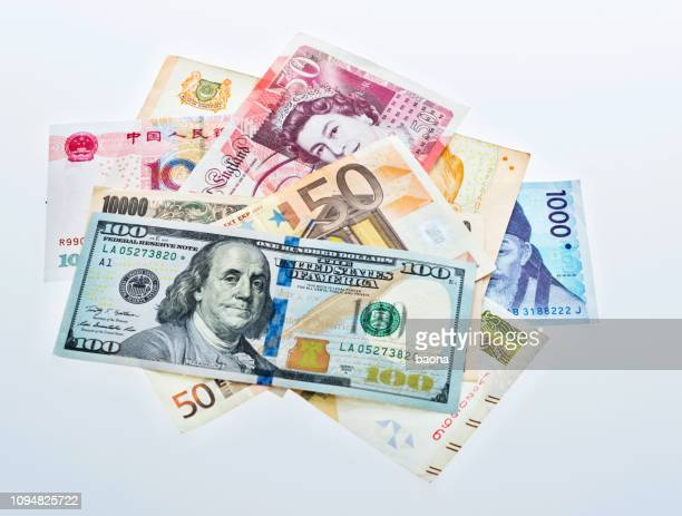 international currency notes on white background - currency exchange stock pictures, royalty-free photos & images