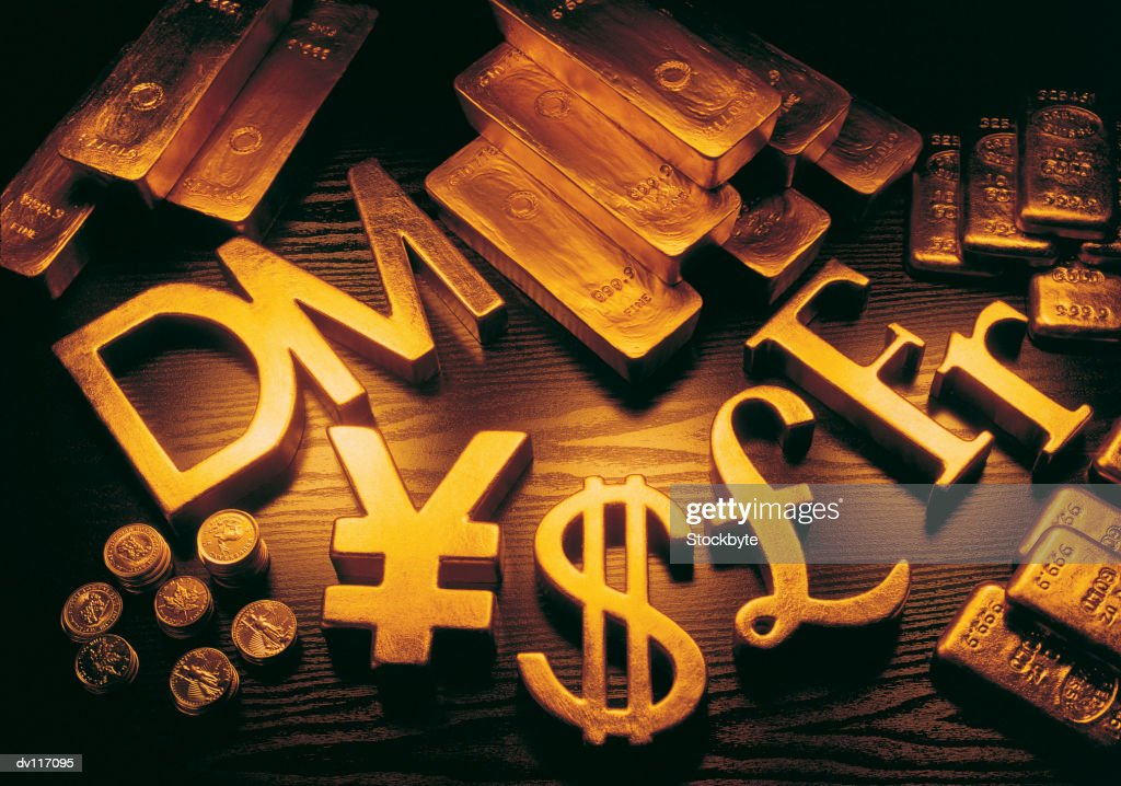 International Currency Symbols Among Coins Gold Bars Stock Photo