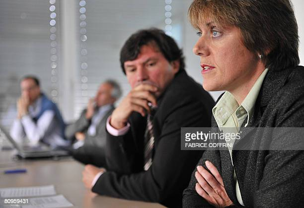 International Cycling Union doctor Mario Zorzoli listens to manager of the UCI's antidoping services team Anne Gripper during a press conference to...