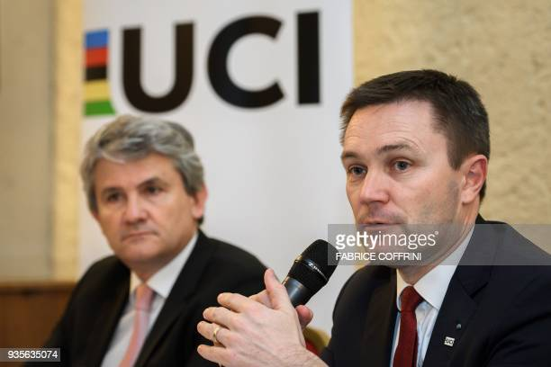 International Cycling Union president David Lappartient speaks next to CEA Tech deputy director Gabriele Fioni during a press conference unveilling a...