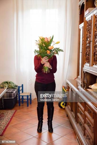 International Day for the Elimination of Violence Against Women-woman with flowers