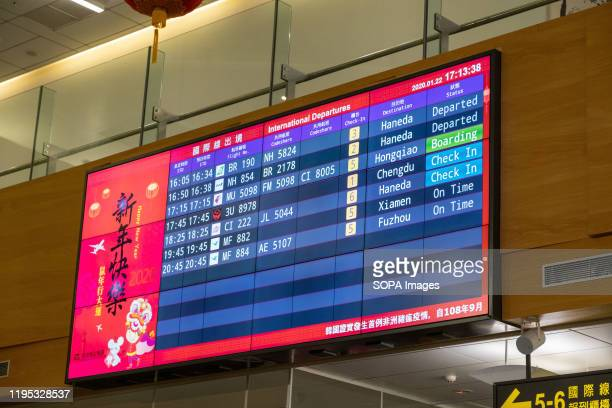 International departures information board seen at Songshan International Airport. Taiwans officials ordered to stop sending and receiving groups of...