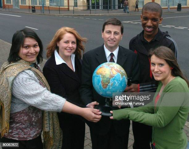 International development secretary Douglas Alexander poses with students as he launches the new government backed global volunteering scheme at...