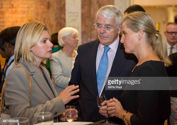 International Development Secretary Justine Greening former British Prime Minister Sir John Major and The Countess of Wessex at The Royal Society in...