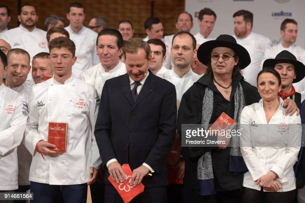 International director of the Michelin guide book Michael Ellis chef Marc Veyrat Anne Sophie Pic pose with newly named France's threestars twostars...