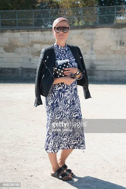 International Editor Laura Hinttula is wearing Celine sunglasses Zara dress Comme Des Garcon clutch Birkenstock sandals and H and M jacket on day 4...
