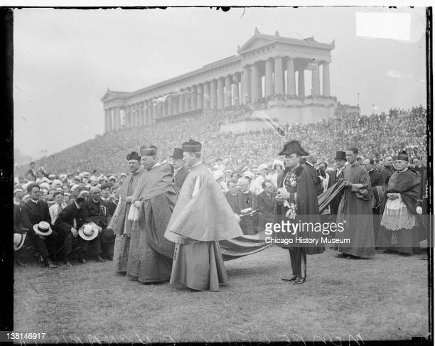 International Eucharistic Congress with a clerical procession forming to the side in Soldier Field Chicago Illinois 1926