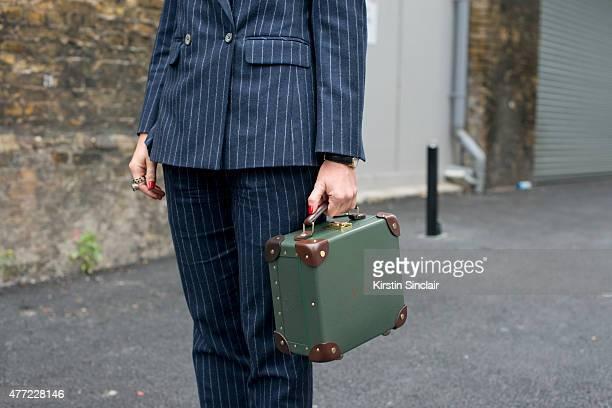 International Fashion editor for The Rake magazine Sarah Ann Murray wears a bespoke Vitale Barberis Canonico suit Globe Trotter bag on day 3 of...