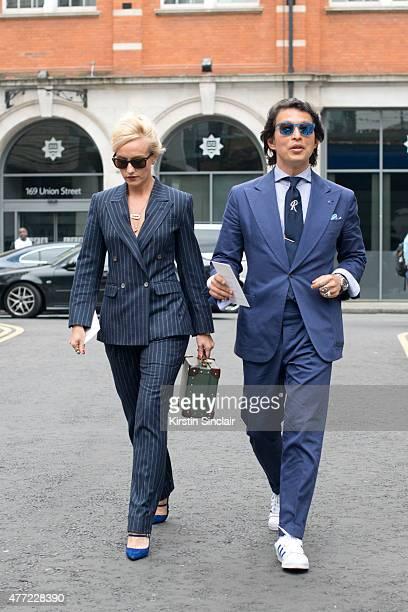 International Fashion editor for The Rake magazine Sarah Ann Murray wears a bespoke Vitale Barberis Canonico suit Globe Trotter bag Nicholas Kirkwood...
