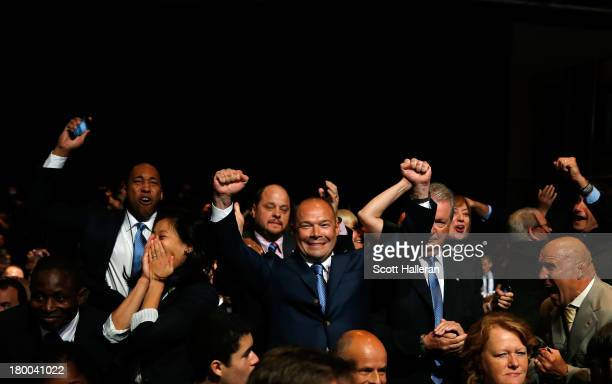 International Federation of Associated Wrestling Styles delegation celebrate as their sport is voted to be included in the 2020 Summer Olympic Games...