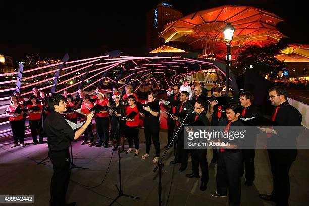 International Festival Chorus performs during the Christmas by the River launch on December 4 2015 in Singapore The annual lightup festival...
