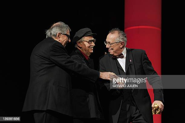 International Film Festival Berlinale director Dieter Kosslick greets Italian directors Vittorio and Paolo Taviani before giving them the Golden Bear...