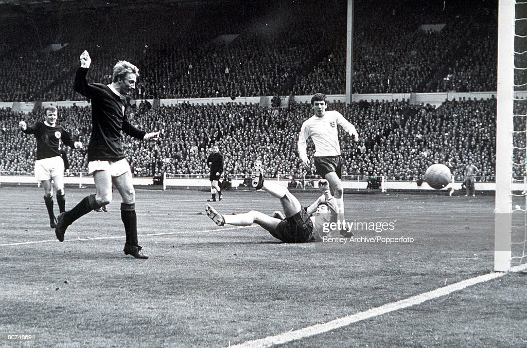 International Football Wembley Stadium. 1967. England 2 v Scotland 3. Scotland's Denis Law beats England goalkeeper Gordon Banks to score the first goal . : News Photo