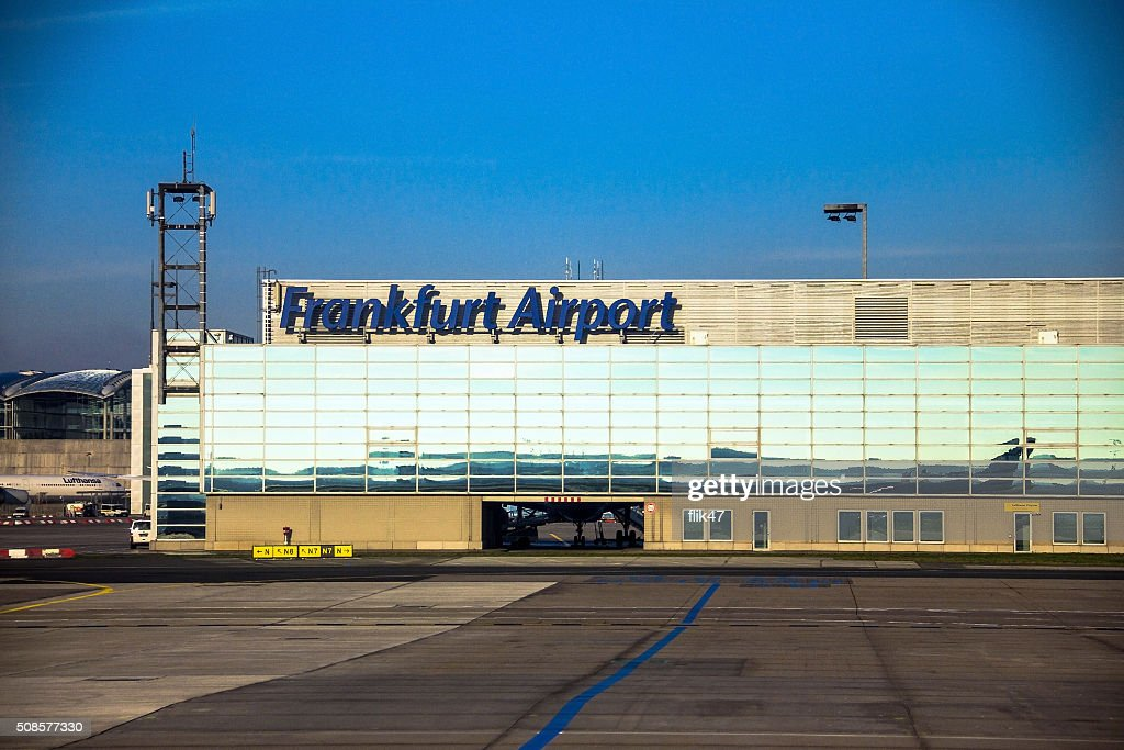 International Frankfurt Airport on blue winter sky background : Stock Photo