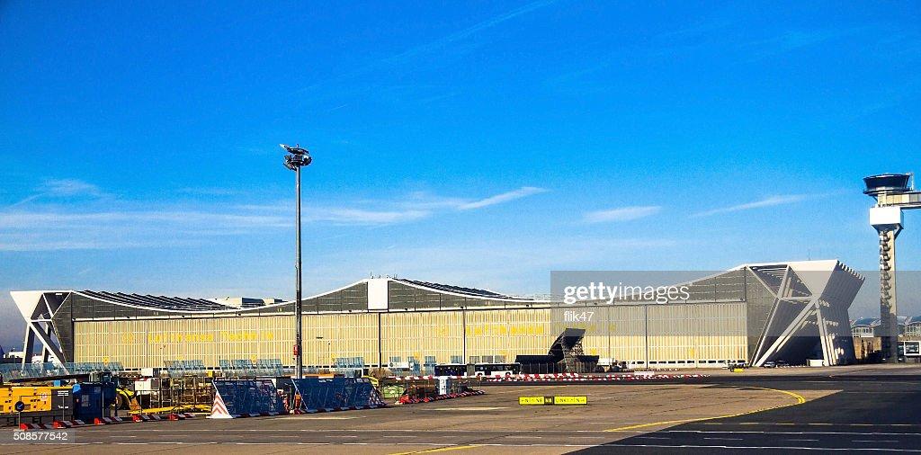 International Frankfurt Airport on blue winter sky background : Stock Photo