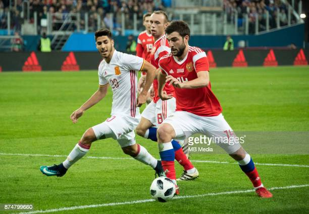 International friendly football match at Saint Petersburg Stadium. The game ended in a 3-3 draw. Spain's Marco Asensio , Russia's Denis Glushakov and...