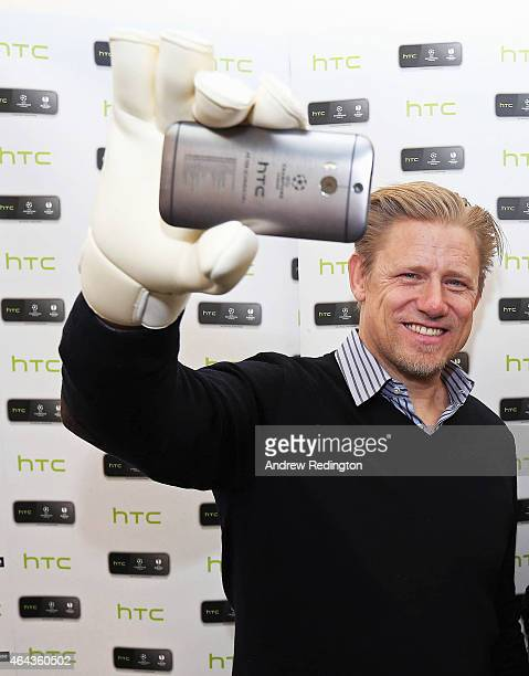 International goalkeeper Peter Schmeichel launches HTC's UEFA Collectors Edition 'Champions' handset at Carphone Warehouse on February 24 2015 in...