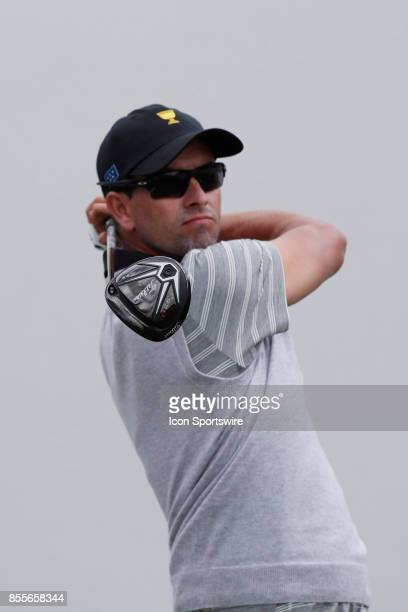 International golfer Adam Scott tees off on the first hole during the second round of the Presidents Cup at Liberty National Golf Club on September...