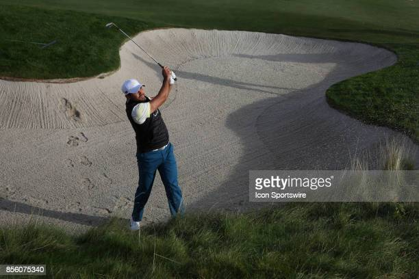 International golfer Jason Day hits out of a sand trap on the 9th hole during the third round of the Presidents Cup at Liberty National Golf Club on...