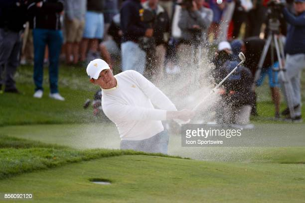 International golfer Si Woo Kim hits out of a sand trap on the 16th hole during the third round of the Presidents Cup at Liberty National Golf Club...